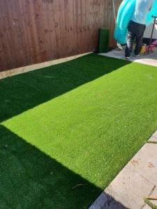 artificial grass being layed by ss flooring