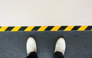 person standing on safety flooring